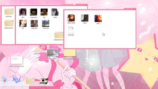 Cibele: il desktop del computer della protagonista con 2 cartelle aperte. Lo sfondo e il tema sono rosa, con l'immagine di sfondo che sembra tratta da un anima majokko come Creamy Mamy; sulla destra una stella obesa con la faccia.