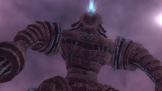 Immagine di un boss gigantesco che spara una luce blu dalla bocca.
